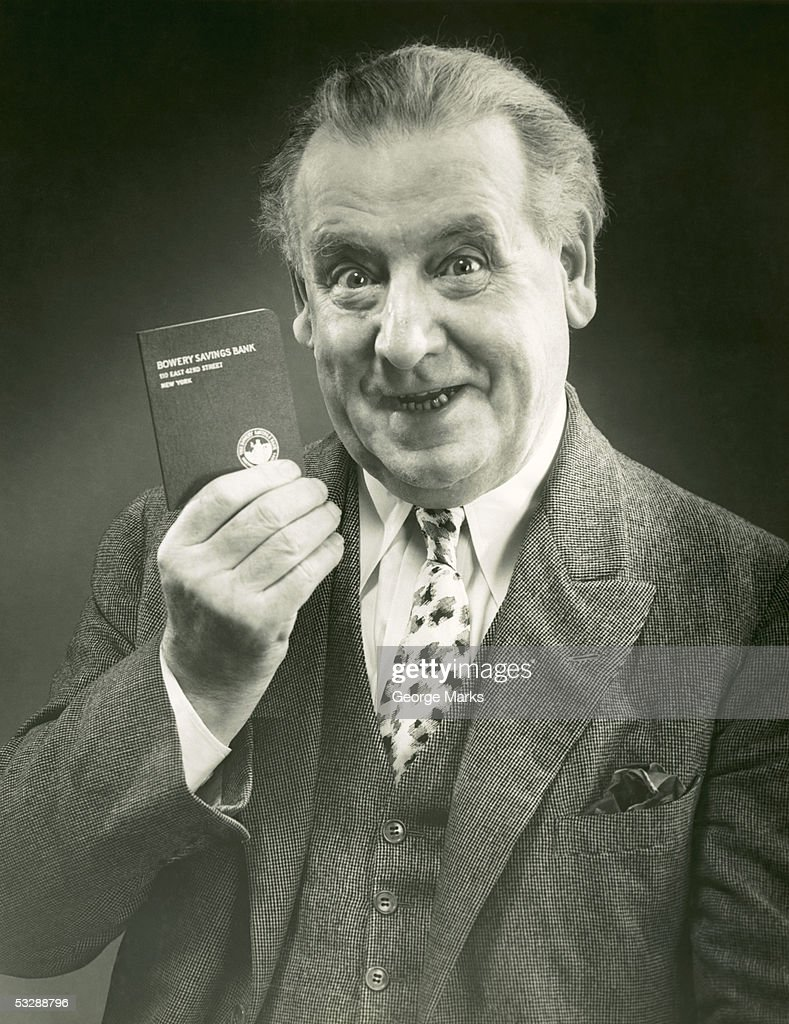 Man holding bank book : Stock Photo