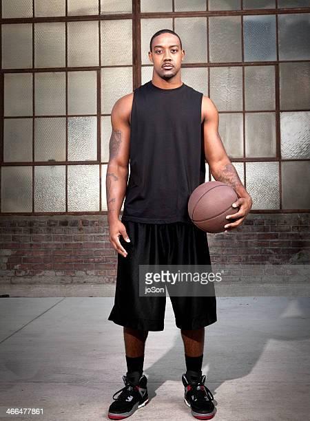 man holding basketball