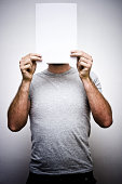 Man Holding Blank Sheet Paper in Front of Face