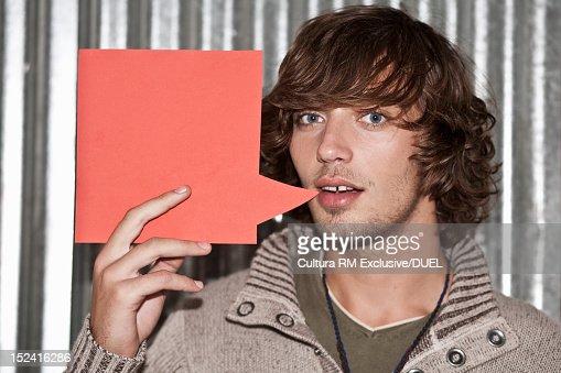 Man holding blank speech bubble : ストックフォト