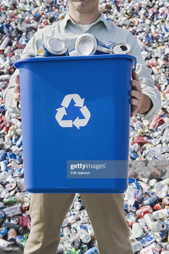 Man holding blue bin : Stock Photo