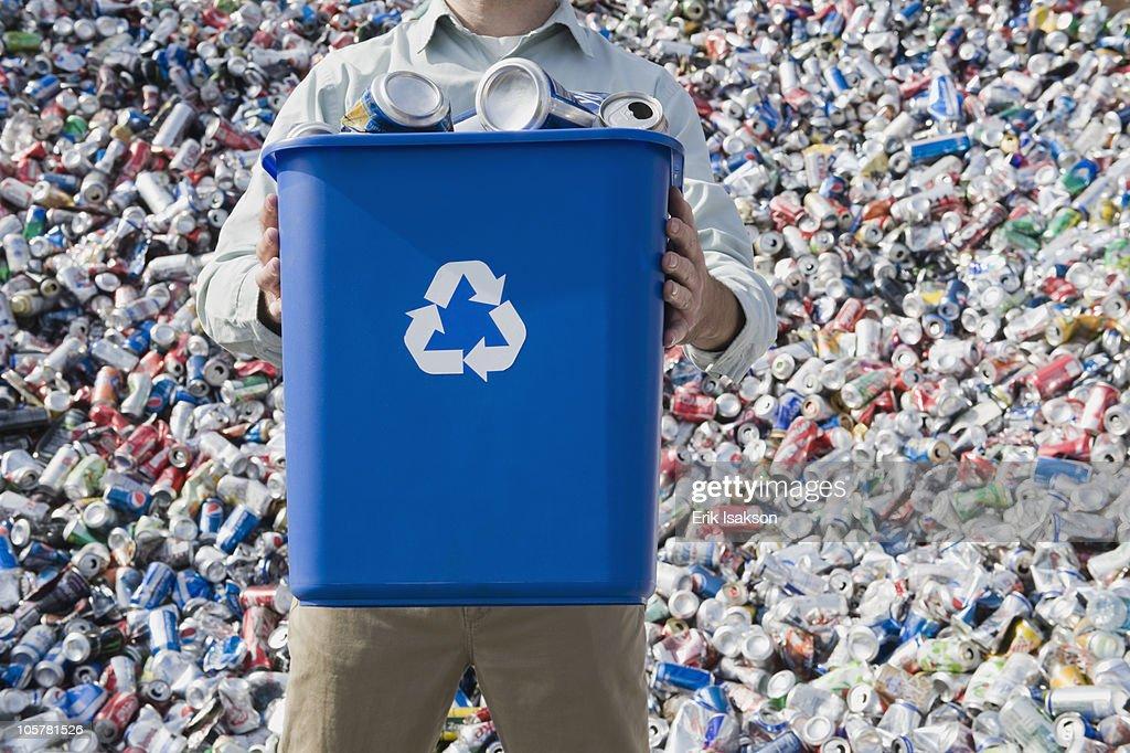 Man holding blue bin : Stock Photo