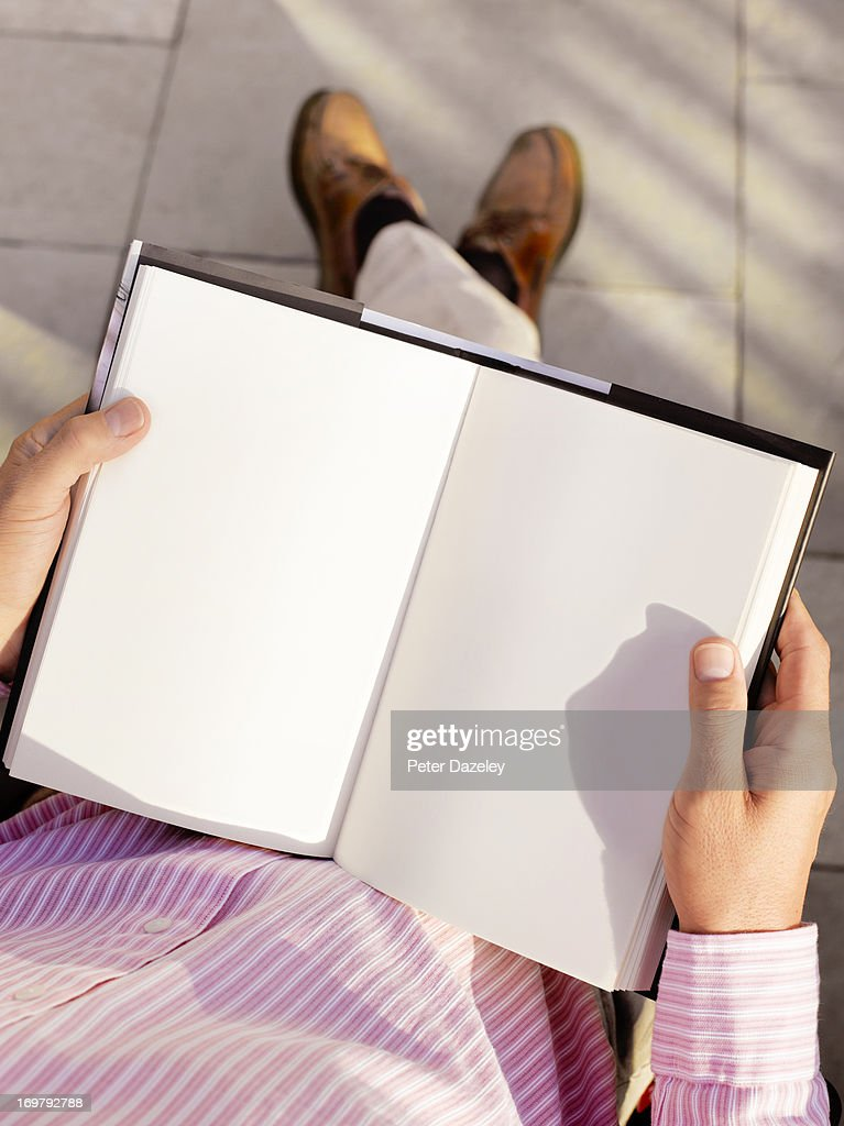 Man holding book with copy space
