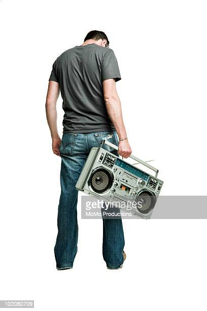 Man holding boom box.