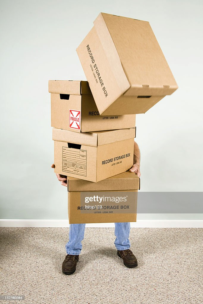 Man holding boxes Falling from stack