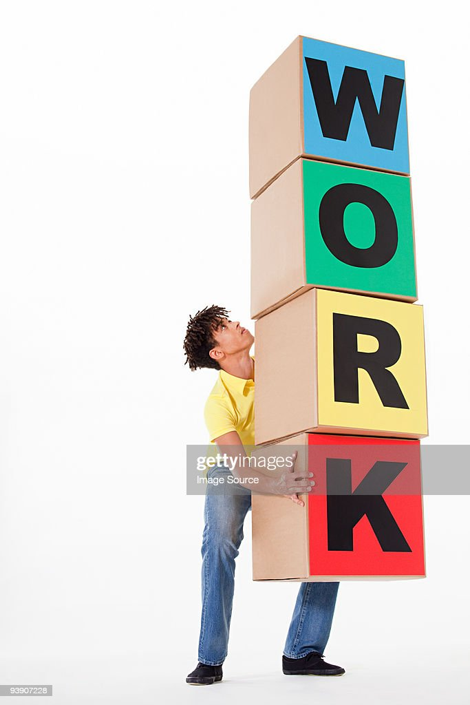 Man holding boxes that spell work : Stock Photo