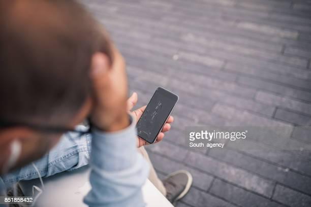 Man holding broken  phone