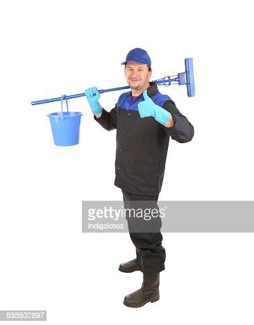 Man holding broom and bucket. : Stock Photo