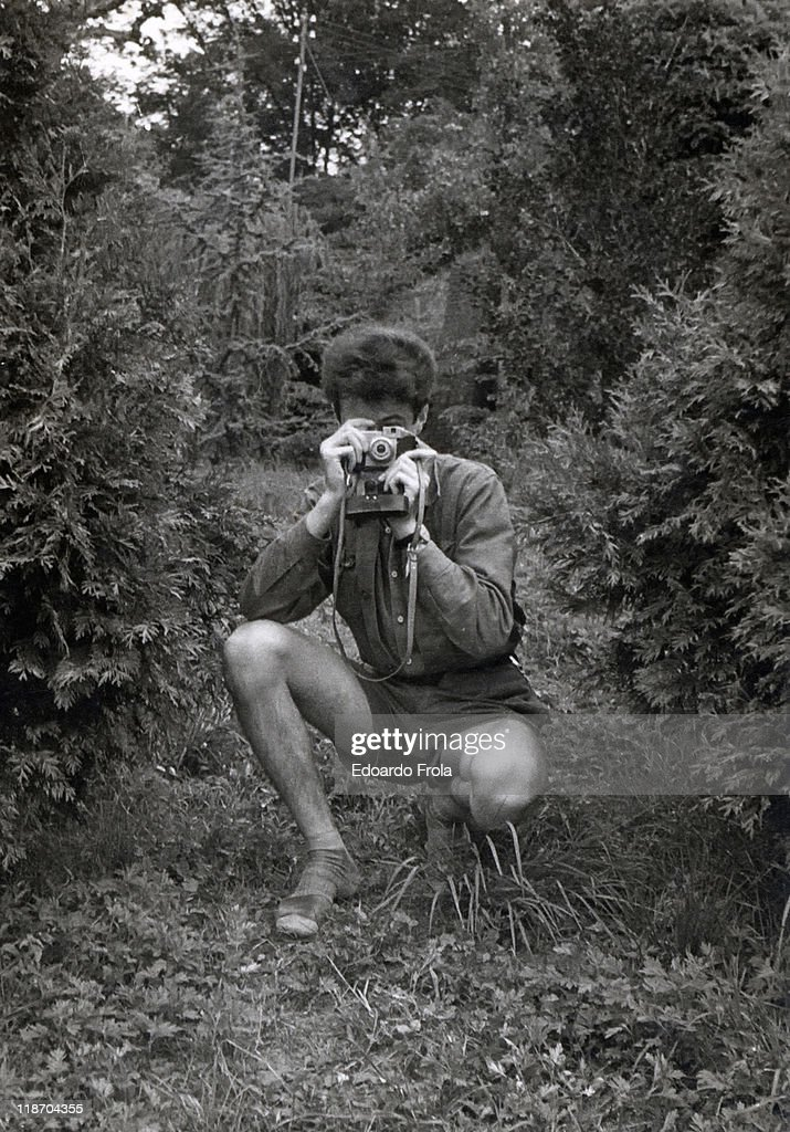 Man holding camera in forest : Stock Photo