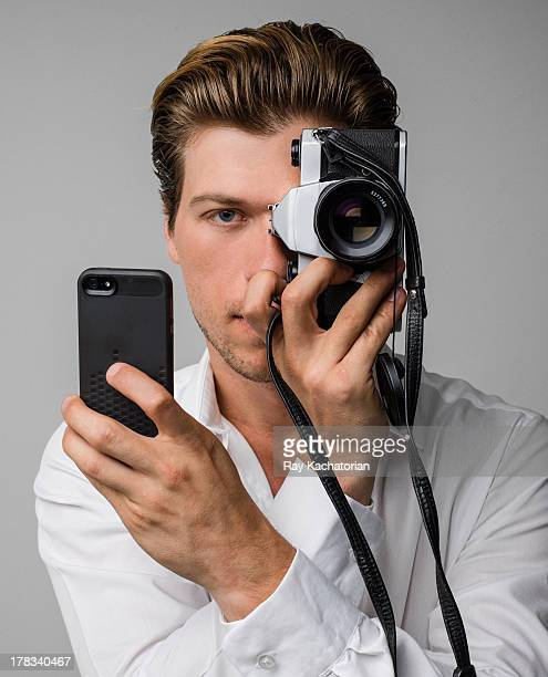 Man holding camera to eye