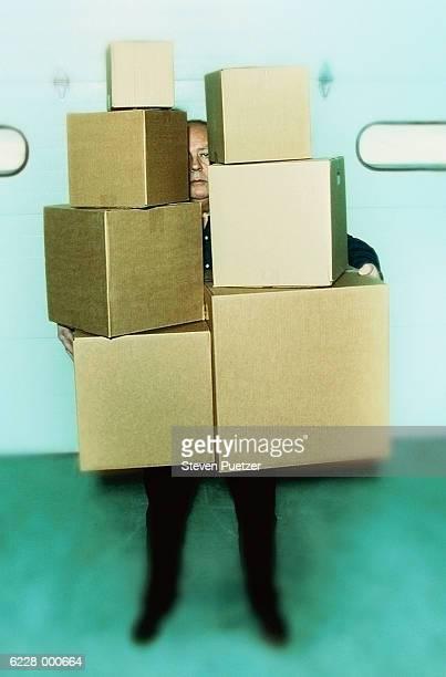 Man Holding Cardboard Boxes