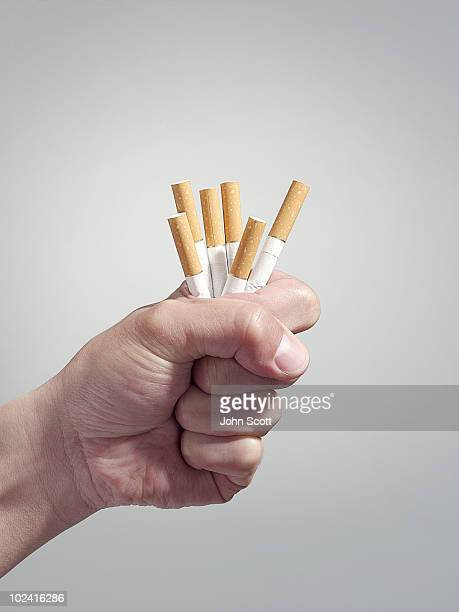 Man holding cigarettes