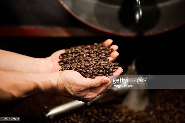 Man holding coffee beans