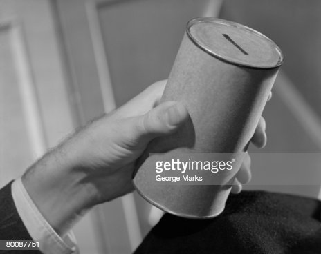 Man holding collection jar : Stock Photo