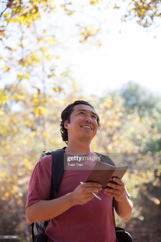 Man holding diary : Stock Photo
