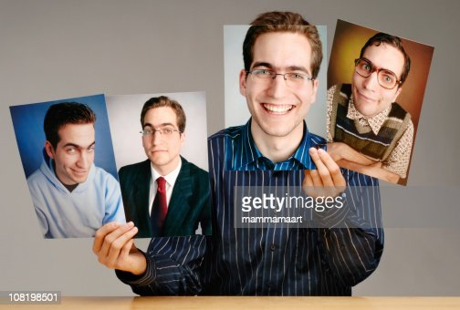 Man Holding Different Photographs of Himself : Stock Photo