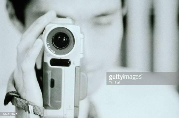 Man Holding Digital Camera
