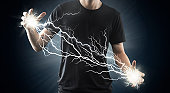 Man holding Electric energy sparks between hands.