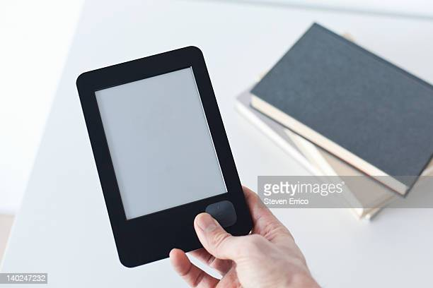 Man holding electronic book reader