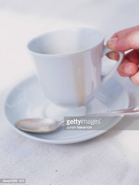 Man holding empty coffee cup, close-up