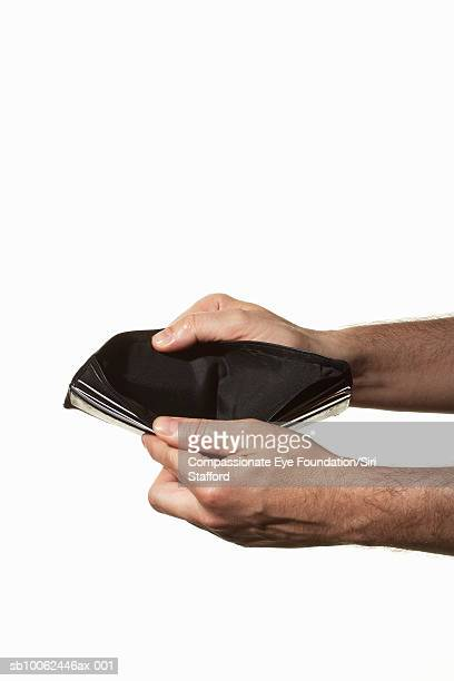 Man holding empty wallet, close-up of hands