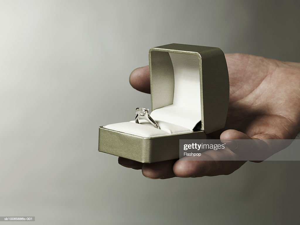 Man holding engagement ring