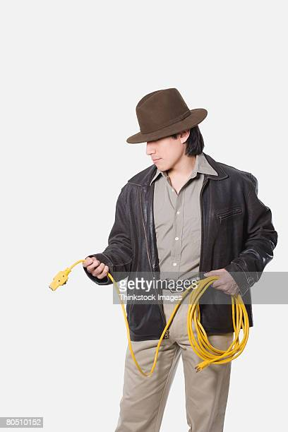 Man holding extension cord
