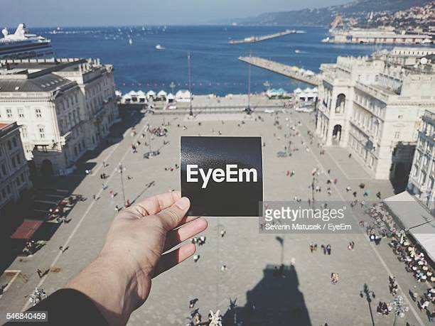 Man Holding EyeEm Sign Over Piazza Unita D Italia