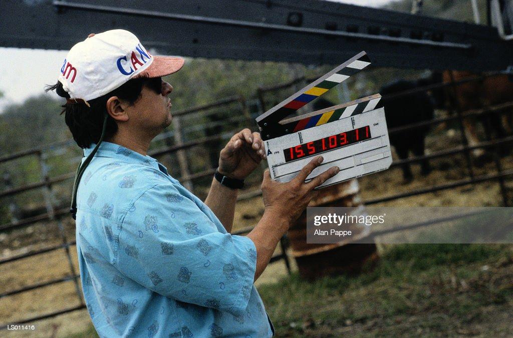 Man holding film slate on movie set