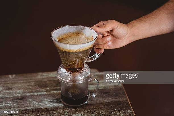 Man holding filter coffee maker