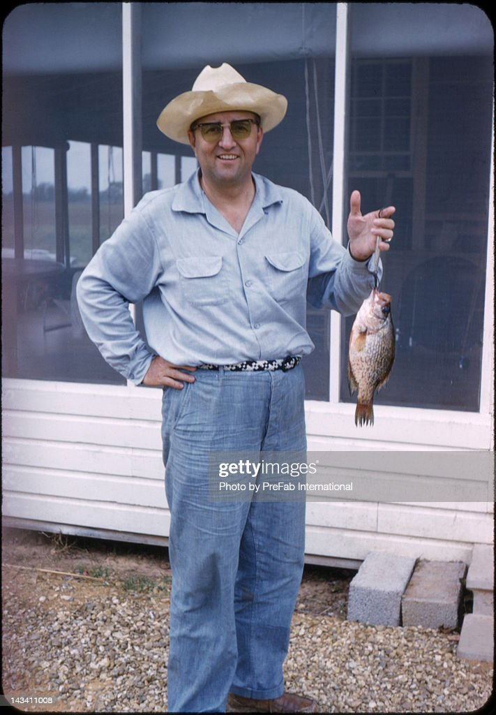 Man holding fish : Stock Photo