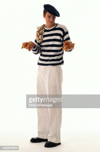 Man Holding Garlic & Onions