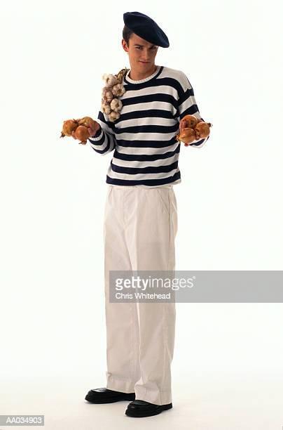 Man Holding Garlic & Onions