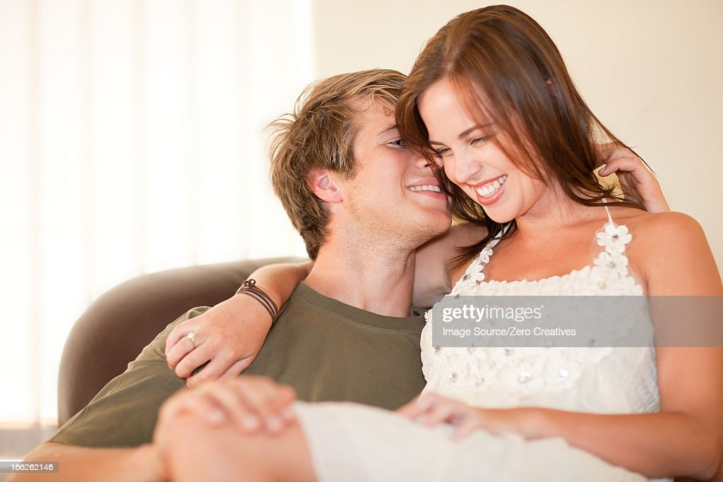 Man holding girlfriend on his lap