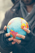 Close Up Of Man Hands Holding Globe