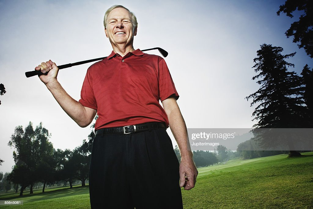 Man holding golf club on golf course
