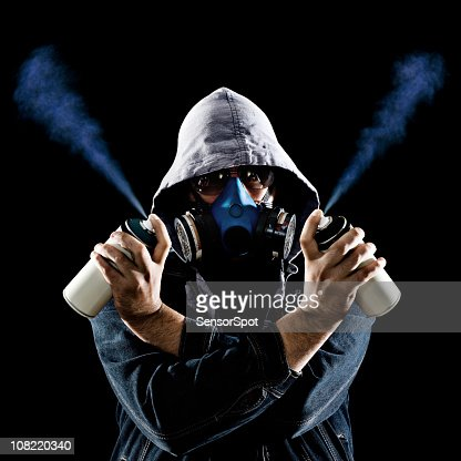 man holding graffiti spray paint cans stock photo getty. Black Bedroom Furniture Sets. Home Design Ideas