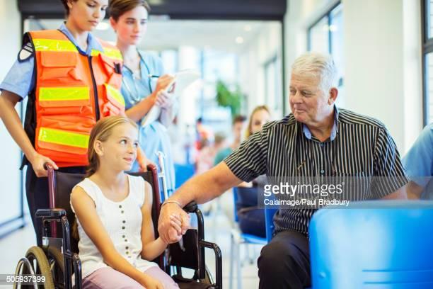 Man holding granddaughterÕs hand in hospital