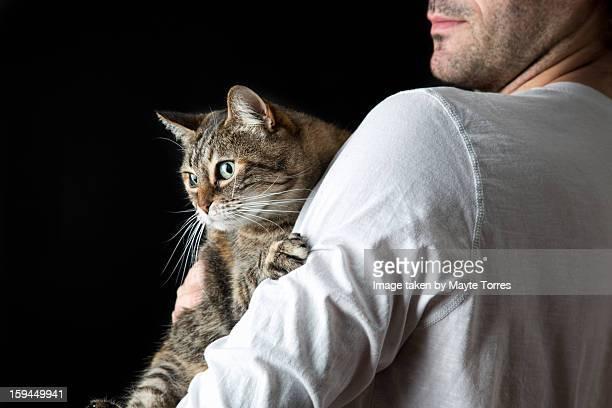 Man holding grey cat
