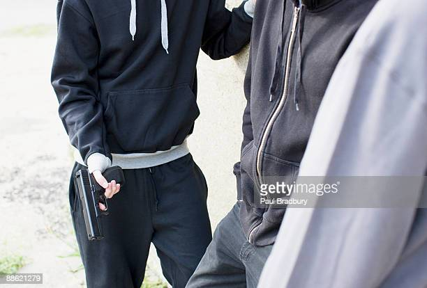 Man holding gun and standing with friends