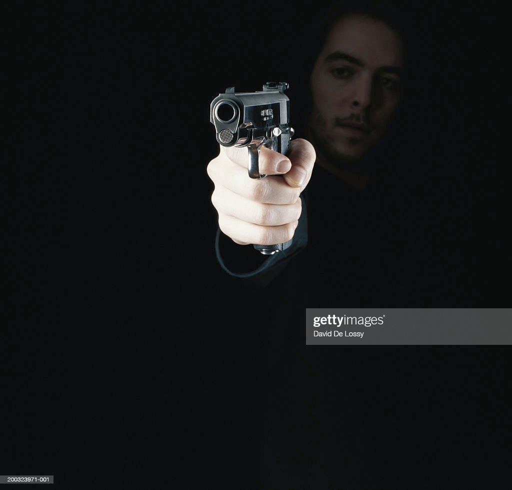Man holding gun, close-up