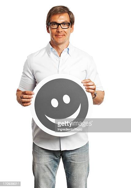 Man holding happy smile sign isolated on white background.