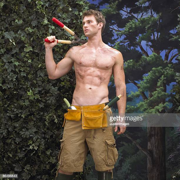 Man holding hedge clippers