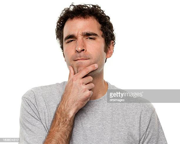 Man holding his chin in a deep-in-thought expression