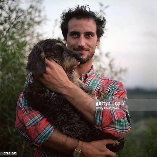 Man holding his dog