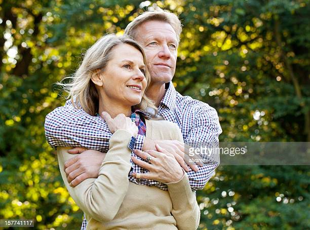 Man holding his wife tightly in love