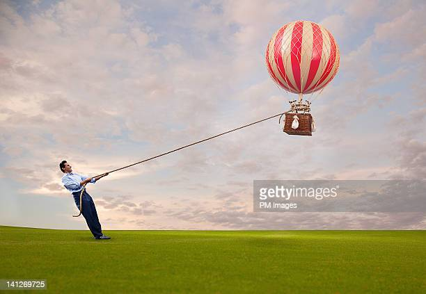 Man holding hot air balloon