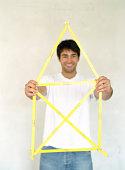 Man holding house shaped frame