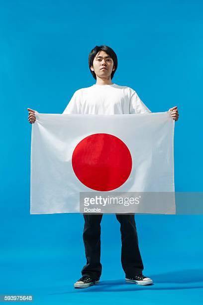 Man Holding Japanese Flag