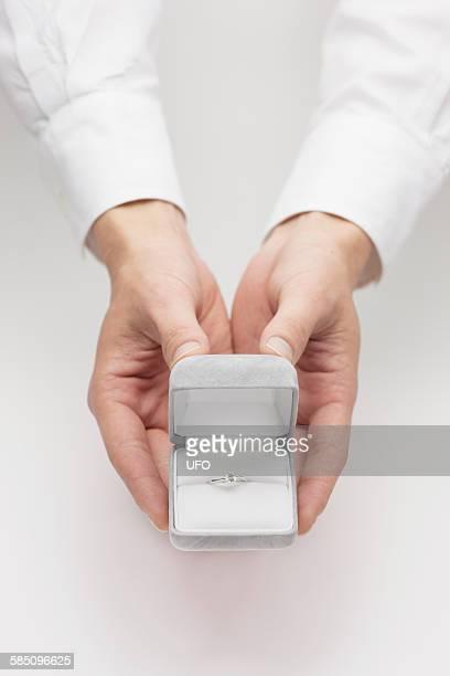Man holding jewelry